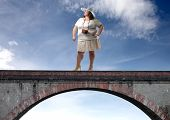 stock photo of fat woman  - Portrait of a fat woman standing on a bridge - JPG