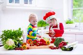 image of vegetarian meal  - Kids cooking fresh vegetable salad in a white kitchen - JPG