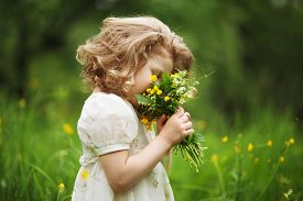 picture of girlie  - Happy little girl smelling a bouquet of flowers - JPG