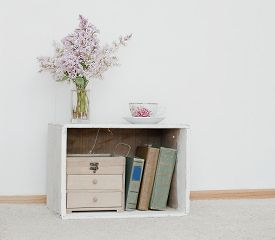 foto of curio  - gentle bunch of lilac and china teacup on vintage shabby bedside table with wooden box and ancient books inside - JPG