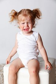 picture of love hurts  - Portrait of an upset baby throwing a tantrum - JPG