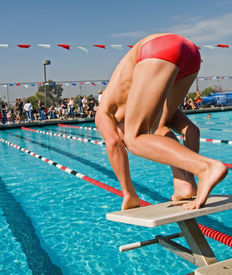 picture of swim meet  - The swimmers compete hard in the high school league championships - JPG