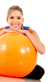 stock photo of workout-women  - Sportive woman with a pilates ball  - JPG