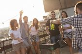 Young Friends Making Barbecue, Drinking Beer And Enjoying Hot Summer Days Having Fun On A Rooftop Pa poster