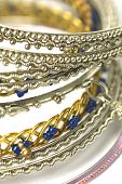 stock photo of sweatshop  - collection of fashion bangles crafted in asia on white - JPG