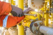 The Production Operator Adjusting Pressure Regulator Of Instrument Gas Supply System, Offshore Oil R poster