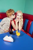 stock photo of kissing couple  - Funny guy kissing a girlfriend - JPG