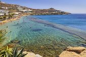 Paradise Beach ,kalamopodi, Of Mykonos, Greece. Sunny With Blue Sky And Crystal Clear Water. Paradis poster