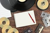 Retro Audio Devices And Blank Notebook. Work Space With Vinyl Records, Compact Discs, Analogue Casse poster