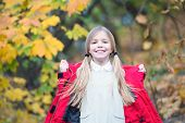 Child Blonde Long Hair Walking In Warm Jacket Outdoor. Girl Happy In Red Coat Enjoy Fall Park Good W poster