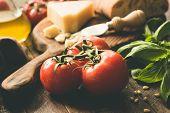 Tomatoes On Vine, Parmesan Cheese, Olive Oil, Basil And Ciabatta Bread. Italian Cuisine Food Ingredi poster