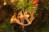 Gorgeous Shiny Gold French Horn Shaped With Ribbon Bow Christmas Ornament Hanging On Sparkling Chris poster