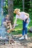 Girl In Straw Hat Cooking Food At Campfire Nature Background. Camping Tips. Tips Every Camper Should poster