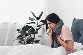 Sick Young Woman Sitting In Bed And Having Cough While Suffering From Sore Throat poster