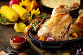Christmas Or Thanksgiving Homemade Roasted Turkey, Potato Gratin And Grill Corn On Dark Rustic Backg poster