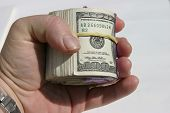 foto of ten thousand dollars  - Ten Thousand Dollars rolled up with yellow rubber band - JPG