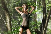 foto of wet pants  - Young sexy girl posing in the forest at night - JPG