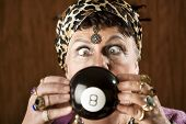 foto of witch ball  - Gypsy looking at an eight ball to predict the future - JPG