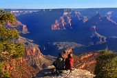 stock photo of grand canyon  - An image of some hikers enjoying the amazing view of the Grand Canyon - JPG