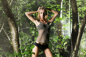 stock photo of wet pants  - Young sexy girl posing in the forest at night - JPG