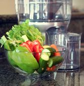 picture of juicer  - fresh vegetables with juicer in the background - JPG