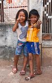 Two Young Girls Posing Outside In Siem Reap Cambodia