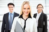 stock photo of leader  - Group of business people with business woman leader on foreground - JPG