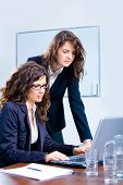 Businesswomen Using Laptop