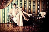 stock photo of muse  - Charming fashionable model posing in the vintage interior - JPG