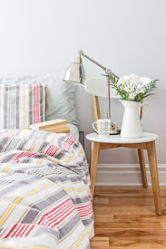 foto of pillowcase  - Bright and fresh bedroom decorated with a bouquet of flowers - JPG