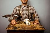 picture of taxidermy  - Hunter With taxidermy Diorama on a wooden table - JPG
