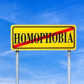 picture of stop hate  - Homophobia written on yellow street sign and crossed off - JPG