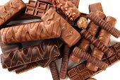 stock photo of filbert  - Delicious chocolate bars with nuts close up - JPG