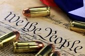 image of bill-of-rights  - US Constitution Bill of Rights with 45 caliber bullets and American flag - JPG