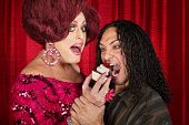 image of drag-queen  - Tall drag queen and hungry man eating cupcakes - JPG