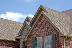 stock photo of shingles  - Roof line of a house with gabels - JPG