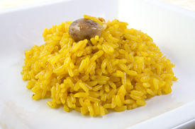 stock photo of giblets  - A dish of risotto with saffron and giblets - JPG