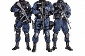 stock photo of terrorist  - Special weapons and tactics SWAT team officers with guns