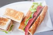 pic of cheesesteak  - club sandwich and Beef steak sandwich on white dish - JPG