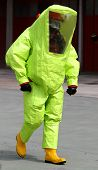 stock photo of rubber mask  - person with anti radiation suit yellow and yellow rubber boots to guard against the risk of bacteriological and chemical biological attack - JPG