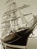 foto of big-rig  - Sailship in port add effect vintage style - JPG