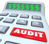 picture of financial audit  - Audit word on a calculator financial book keeper accountant reviewing money irregularity - JPG