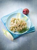 stock photo of endive  - salad with sauteed endive onions and pine nuts - JPG