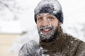 image of cold-shoulder  - Portrait of a young man covered in snow - JPG
