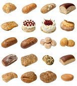 stock photo of baps  - A selection of freshly baked bread baps and cakes isolated on a white background - JPG