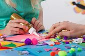 stock photo of card-making  - Woman helping girl in making beautiful cards - JPG