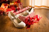 image of shoe-box  - White female elegant shoes in a gift box with christmas tree and presents on background - JPG