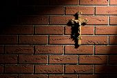 image of crucifix  - crucifix with Jesus on brick wall - JPG
