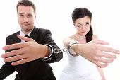 stock photo of handcuff  - Break up ending relationship between husband and wife - JPG