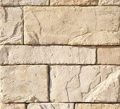 stock photo of tile cladding  - Cladding tiles imitating stones in sunny day